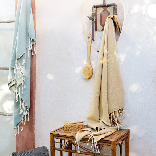 Laza Hammam Towel in mustard & white | Home & Living inspiration | URBANARA