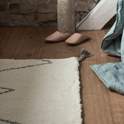 Beni Rug in natural white & charcoal melange | Home & Living inspiration | URBANARA