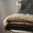 Gotland Dia Wool Blanket in light brown & cream | Home & Living inspiration | URBANARA
