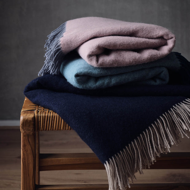 Jonava Merino Wool Blanket in dark blue & natural | Home & Living inspiration | URBANARA