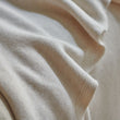 Salicos Blanket in off-white melange | Home & Living inspiration | URBANARA