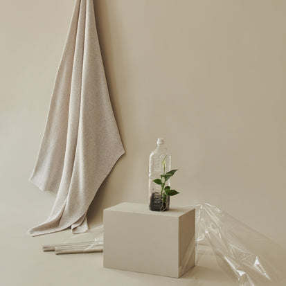 Amaro Recycled Fiber Blanket in light grey melange | Home & Living inspiration | URBANARA