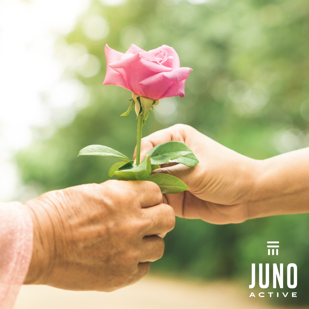 JunoActive Celebrates Mother's Day a rose being handed from daughter to mother
