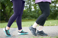 two women walking on sidewalk wearing JunoActive Plus size women's activewear