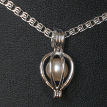 Load image into Gallery viewer, Freshwater 7-8mm Pearl with Sterling Silver Cage