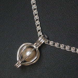Freshwater 7-8mm Pearl with Sterling Silver Cage