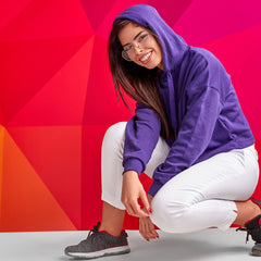 Girl wearing purple hoodie with white tailored pants