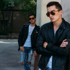 Two guys leather jackets.