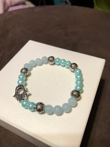 Hamsa Hand with Aquamarine Crystals