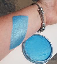 A metallic light blue face and body painting paint produced by Cameleon