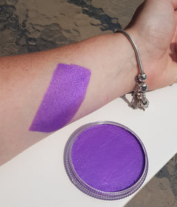 A vibrant metallic purple face and body painting paint produced by Cameleon