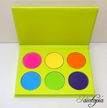 Cameleon eyeshadow palette containing six bright colours in pink, yellow, orange, blue, green and purple
