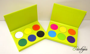 Cameleon eyeshadow palettes, one containing six base colours in white, black, red, yellow, green and blue and the other containing 6 bright colours in pink, yellow, orange, green, blue and purple