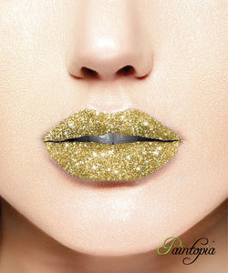 Gold shade of glitter lip in a small box with a glitter bond and applicator