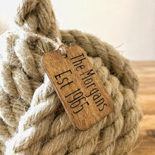 Country cottage inspired natural rope door stop, hand laid natural fibre flax hemp rope made in the UK crafted into a monkey fist knot doorstop
