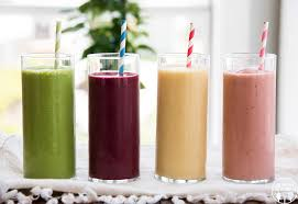 Four different colored smoothies