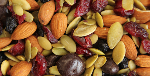 Trail mix combination of nuts, chocolate, and dried fruit