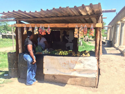 Street side vendor with store assisted by donations from Brenda Smit-James