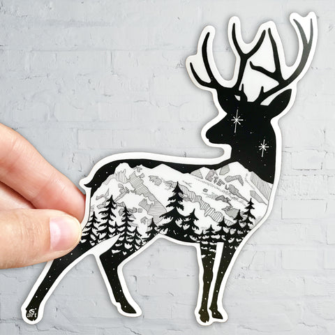 Deer with mountain range and stars.  Sticker