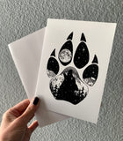 Wolf Paw Greeting Card: features a wolf paw with a wolf howling at a full moon with a hidden big & little dipper; wolf howling at the moon, colorado mountains, constellation, big dipper and little dipper constellation, wolf silhouette, wolf paw silhouette, wolf footprint silhouette, Wolf Paw Silhouette Greeting Card, Wolf Paw Silhouette card