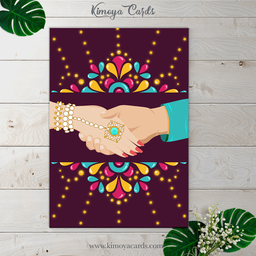 This Indian Wedding Card is a vector illustration of the beautiful moment of unison, where soulmates hold hands and walk towards marital bliss.. This creative & quirky wedding card design is decorated with motifs inspired by kundan & precious gem-stone traditional indian jewellery, which brings an air of glamour that Indian Weddings are famous for..  This is a print ready invite which comes along with a customised envelope.. You can buy this design at Kimoya Cards or visit www.kimoyacards.com