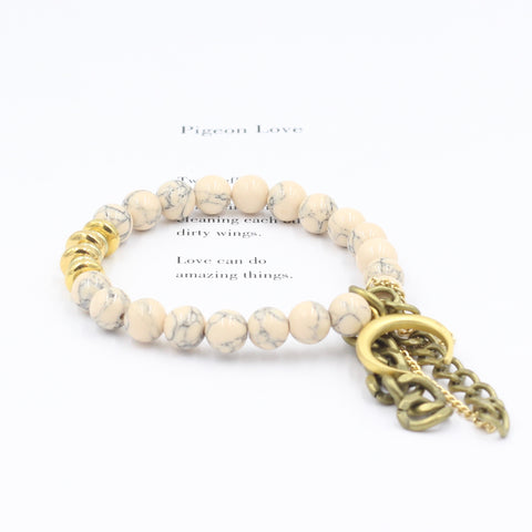 Blush Magnesite Bracelet with Gold Horn