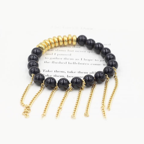 Susan Balaban Designed Healing Bracelet - This black healing yoga bracelet is made of tourmaline and gold fringe for strength and grounding.