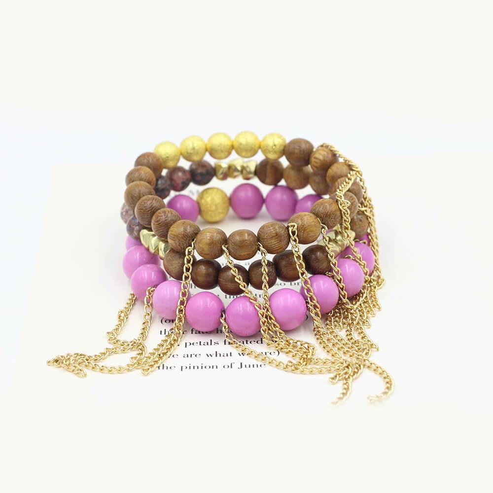 Susan Balaban Designed Healing Bracelet - These purple and brown healing yoga bracelets feature jasper, wood and 14 kt gold stardust balls for new beginnings and energy.
