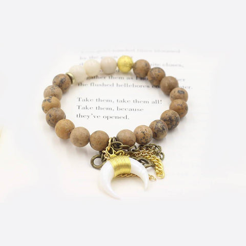Susan Balaban Designed Healing Bracelet - This neutral tan healing yoga bracelet features jasper and a horn charm for reconnecting to the wild spirit.