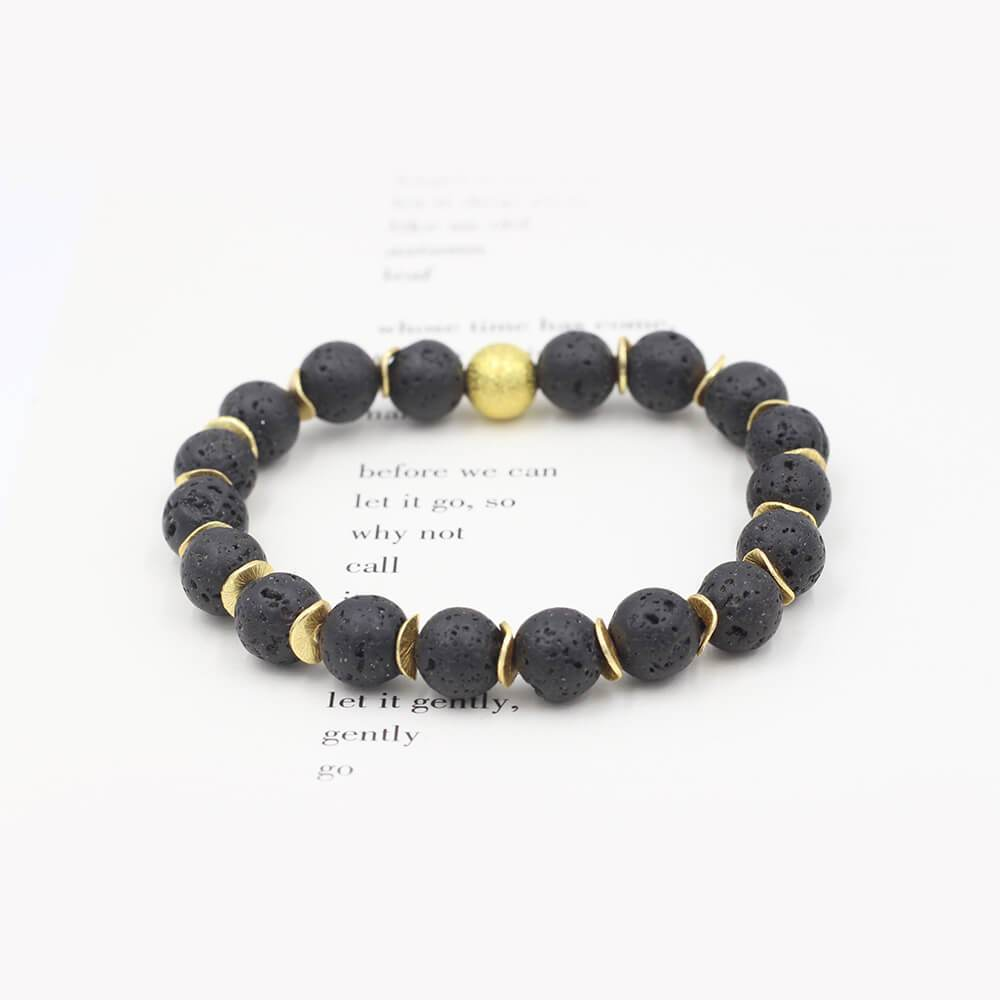 Susan Balaban Designed Healing Bracelet - This black healing yoga bracelet is made of lava stones and gold for adventure.