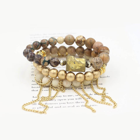 Susan Balaban Designed Healing Bracelet - THese gold and white healing yoga bracelets are made of wood, jasper and riverstone with evil eye for protection, power and positivity.