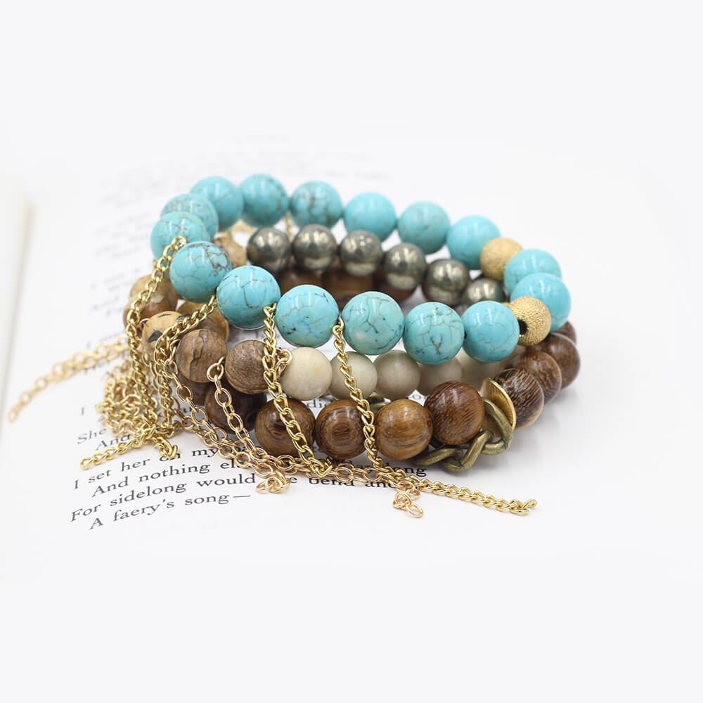 Susan Balaban Designed Healing Bracelet - These blue and turquoise healing yoga bracelets are made of magnesite, wood and jasper with antique coin for expansion and growth.