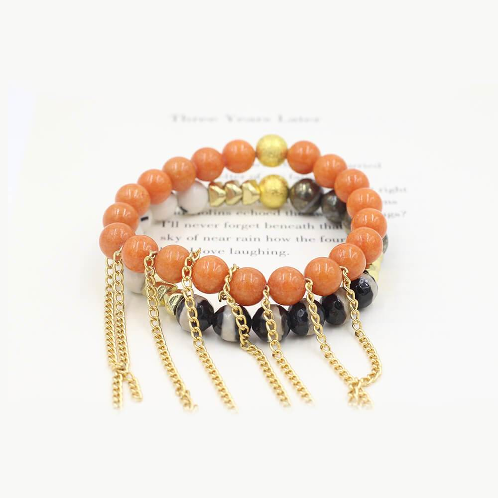 Susan Balaban Designed Healing Bracelet - These orange and black healing yoga bracelets for courage, moving forward, energy.