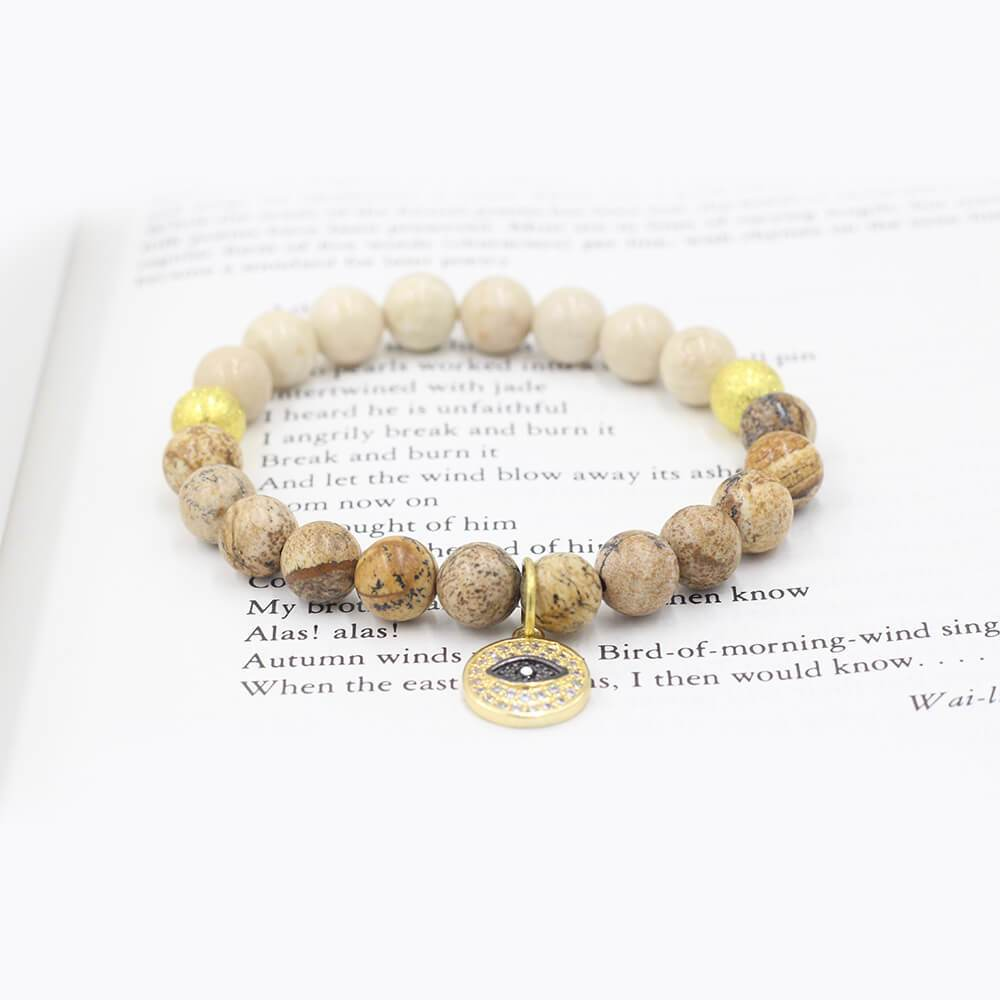 Susan Balaban Designed Healing Bracelet - This cream and gold healing yoga bracelet is made of riverstone & jasper with evil eye.