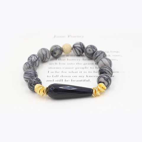 Susan Balaban Designed Healing Bracelet - This gray healing yoga bracelet is made of silkstone and agate for creativity and inspiration.