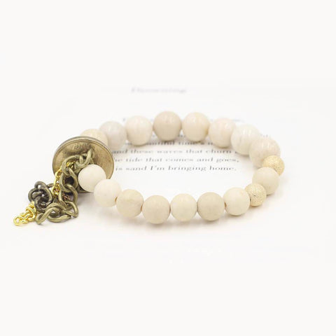 Susan Balaban Designed Healing Bracelet - This cream healing yoga bracelet is made of riverstone & white jasper, fringe & vintage coin for peace.