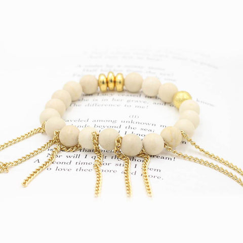 Susan Balaban Designed Healing Bracelet - This cream healing yoga bracelet is made of white jasper and fringe for clarity, gratitude and calm.