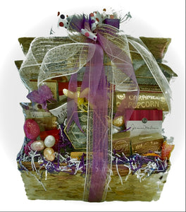 This gift basket is filled with cheese, crackers, Focaccia crisps, wine and cheese biscuits, butter pretzels, fruit medley snacks, caramel popcorn, cookies, a variety of chocolates and so much more!  We cello wrap your gift with a beautiful handmade bow and notecard. We can ship this gift nationwide. We can customize this gift by size, and colors.