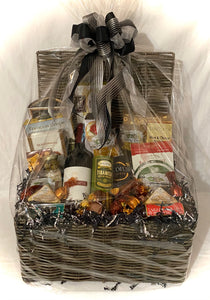 Spanish olives, toffee pretzels, Tira mi su rolled wafers, roasted almonds and cinnamon coated almonds, Italian salami stick, tomato and basil sausage stick, a variety of chocolates and so much more. This beautiful basket comes wrapped in cello, with a notecard and handmade bow. We can deliver locally but cannot ship with wine.  Chat with us here on our website or call, text, email us and we will gladly assist you at 704.526.7407 or perfectselectioncreativegifts@gmail.com and we can assist you with your or