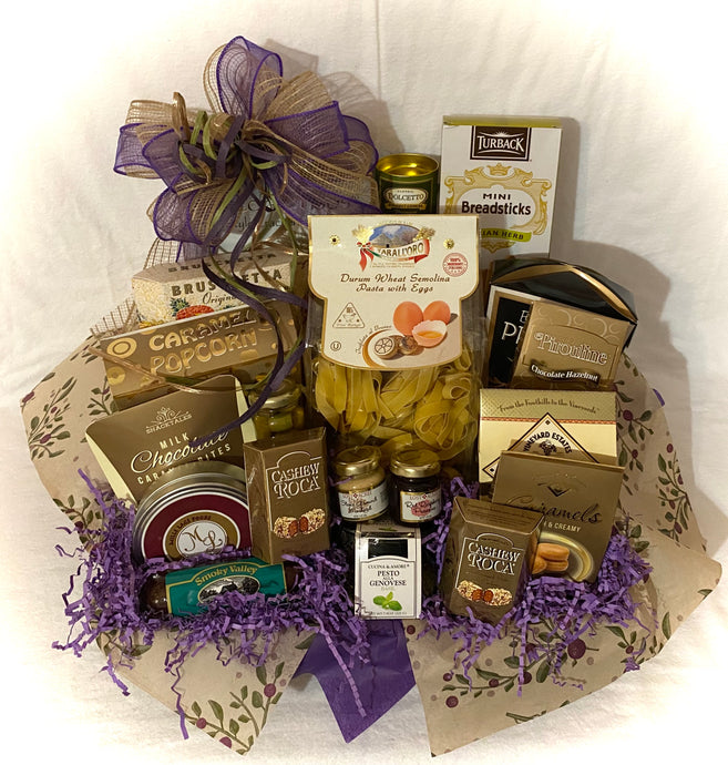 Take Me to Tuscany... A big taste of Italy in this beautifully put-together gourmet basket. This gift basket has something for everyone! Perfect for family, someone who loves Italian food, realtor gift, gift for all occasions. We've included Italian Focaccia Crisps, Tira Mi Su Wafers, Breadsticks, Bruchetta Crisps, Italian Semolina Pasta, Butter Pretzels, Caramel Popcorn, Olives, Jam & Mustard, Italian Salami Stick, Milk Chocolate Caramel Bites, Gourmet Merlot Cheddar Cheese, Pesto Alla Genovese, Vineyard E