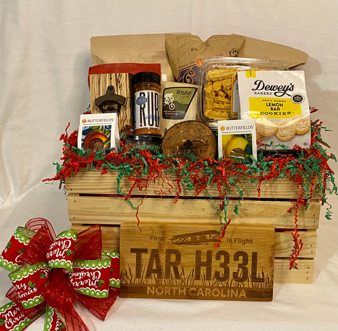 Customized Christmas Crate has hand-selected products from local artisans made in Carolina's. This variety of delicious treats is a perfect combination of good southern love! Our crates come filled with a selection of popcorn, pretzels, soups, grits, honey, couch mix, dips, toffee, chocolate and so much more. We may substitute items of equal or greater value for these crates. They come wrapped in cello, with a notecard and beautiful handmade bow. We can locally deliver these gifts or ship nationwide. Listed