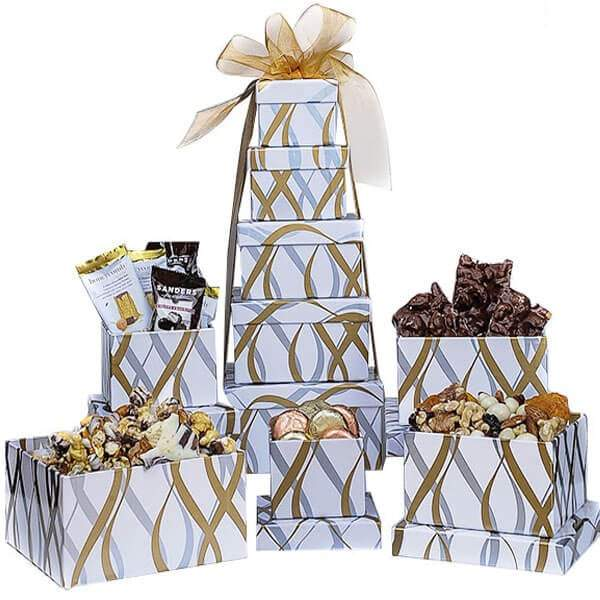 White and Gold Assorted Snack Tower is a collection of five boxes filled with delicious treats for all. This perfect tower is filled with hand-selected delicious treats, candy, and more. We can customize these with ample time for any holiday, birthday, wedding, anniversary, or holiday, etc. For corporate orders please call us. These boxes can be shipped nationwide and delivered locally. These boxes will be wrapped with a beautiful handmade bow for your specific order and include a notecard.