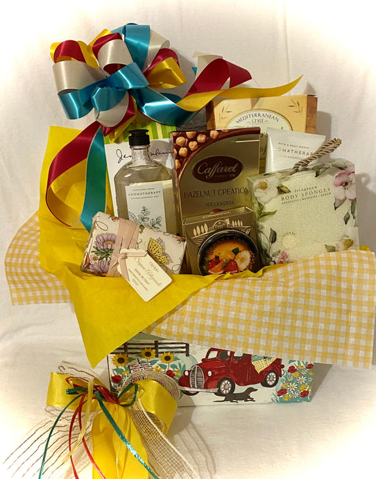 Sending Sunshine Your Way ~ is the perfect gift to brighten someone's day! It is filled with delicious treats to eat and treats to pamper. This gift will brighten your special someone's day! We made this gift for those special moms, nanas, new moms, or for anyone you want to make smile. We've included: Bath & Boday Aromatherapy bath wash and body cream, two regular size exfoliating body sponges, a large size hand-wrapped artisanal soap, Tuscan crisps, toffee peanut snack, lemon tea cookies, cheddar cheese s