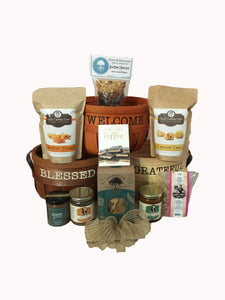 Southern Style Gift Baskets contain hand-selected products from local artisans made in the Carolina's. This variety of delicious treats is a perfect combination of southern love! Our baskets come filled with a selection of popcorn, pretzels, soups, honey, couch mix, dips, toffee, chocolate and so much more. We may substitute items of equal or greater value for our baskets. These baskets are wrapped in cello, with a notecard and beautiful handmade bow.