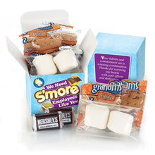 "Load image into Gallery viewer, The S'mores box has an adorable saying on it. We have a large order of these going out to some very special team members! The saying ""Your talents and commitment are a winning combination. Thanks for warming our hearts with your efforts and dedication."" We can get these S'mores kits in a variety of sayings or plain as well. We have kits for all!"