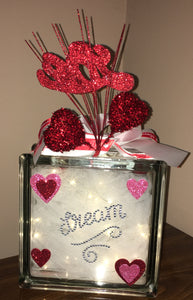 This Valentine's Day Block lights up with battery operated lights or can be ordered with plug-in lights. We can customize a saying and add names as well. We can design this block the way you want. This is a double-sided block that can be placed anywhere or in any room for you Valentine to share. Each block can be customized with your saying of quote.