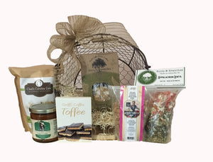 Southern Heart Warmer has hand-selected products from local artisans made in the Carolina's. This variety of delicious treats is a perfect combination of good southern taste! If you want to share some of our southern hospitality then send them this! Our country wire basket comes filled with a selection of Carolina Gourmet Popcorn, Chips, Candy or Chocolate, Crackers, Snack Mix, Soup Mix, and more. Finished in a cello wrap, with a notecard and beautiful handmade bow.