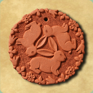 Handmade terracotta tiles featuring designs by William Morris