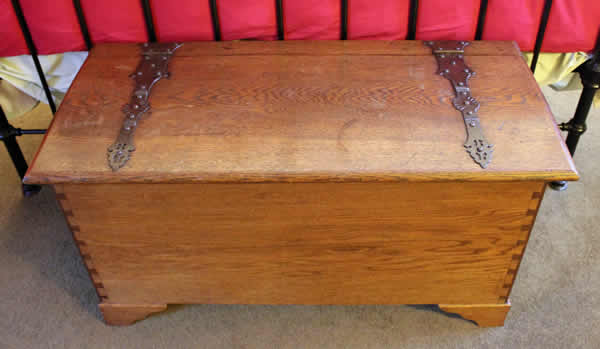 <p>Antique Arts & Crafts Cotswold School oak coffer with handmade hinges.</p>