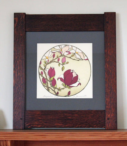<p>Stunning signed  limited edition oak framed block print of a magnolia tree in an Arts and Crafts era inspired design. As though looking through a Chinese moon gate  this decorative circle block print takes us into the natural world around us.</p>